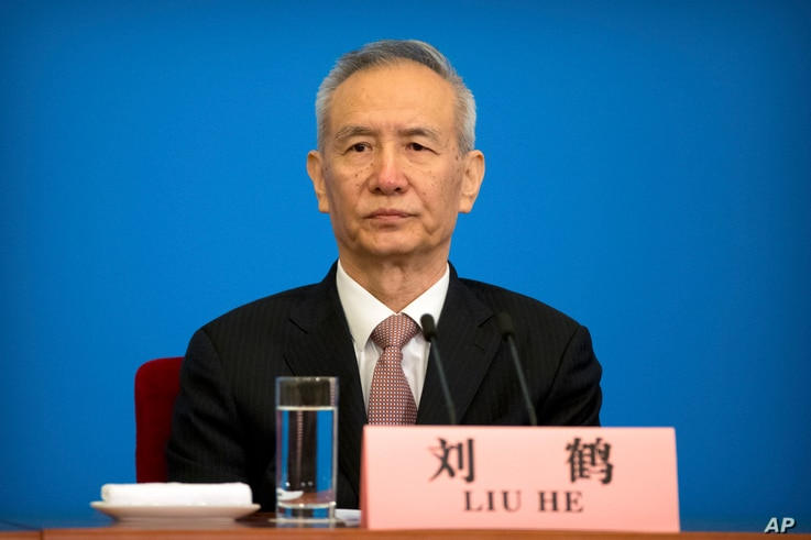 FILE - In this March 20, 2018, photo, Vice Premier Liu He attends a press conference after the closing session of China's National People's Congress (NPC) at the Great Hall of the People in Beijing.
