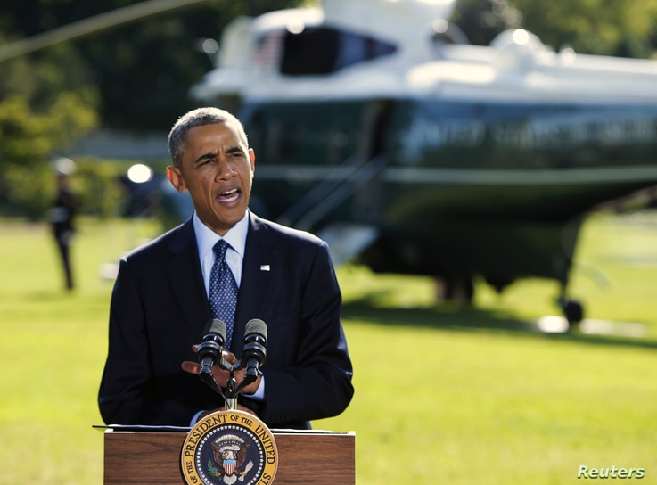 U.S. President Barack Obama delivers a statement at the White House in Washington on the air strikes in Syria, prior to departing for the United Nations in New York, Sept. 23, 2014.