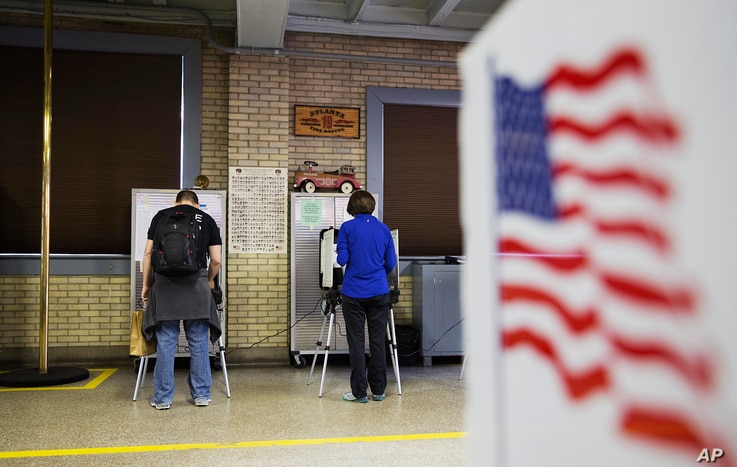 Voters cast ballots in Georgia's primary election at a polling site in a firehouse in Atlanta, Georgia, March 1, 2016.