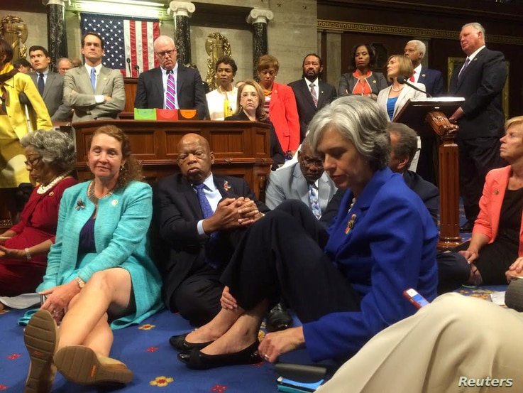 """A photo shot and tweeted from the floor of the U.S. House of Representatives shows Democratic members of the House staging a sit-in on the House floor """"to demand action on common sense gun legislation"""" on Capitol Hill, in Washington, June 22, 2016.  ..."""