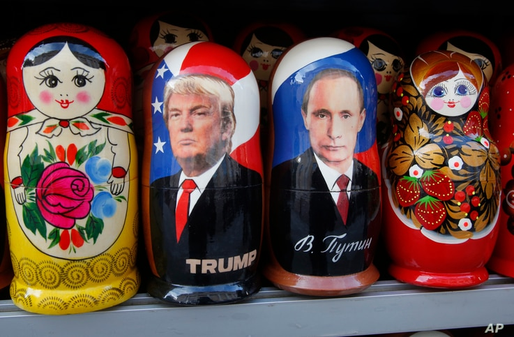 Traditional Russian wooden dolls depicting U.S. President Donald Trump and Russian President Vladimir Putin are displayed for sale at a street souvenir shop in St. Petersburg, Russia, Jan. 20, 2017.