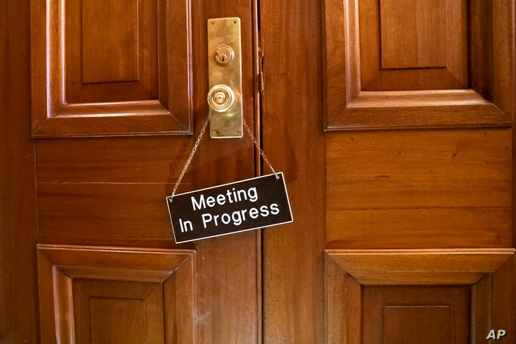 A sign hangs on the Senate Appropriations Committee room at the Capitol as bipartisan House and Senate bargainers trying to negotiate a border security compromise in hope of avoiding another government shutdown, in in Washington, Feb. 11, 2019.