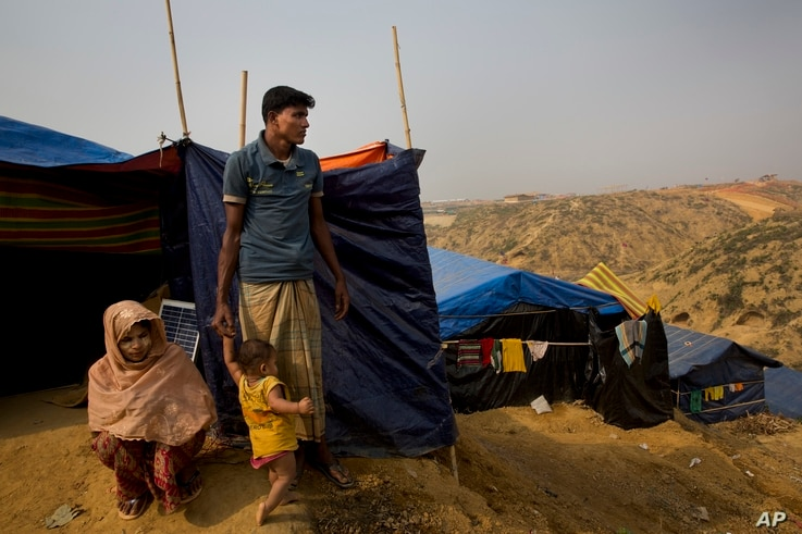 Rohingya Muslim refugee Mohammad Younus, 25, from the Myanmar village of Gu Dar Pyin, stands on a hill of Kutupalong refugee camp, Bangladesh, Jan. 14, 2018.