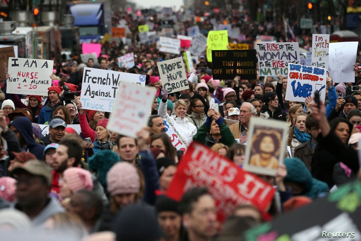 People participate in the Women's March on Washington, following the inauguration of President Donald Trump, in Washington, D.C., Jan. 21, 2017.