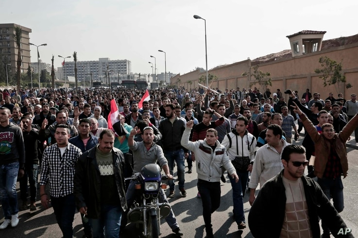Coptic Christians protest on a street after a funeral service for victims of a Sunday cathedral bombing, at the Virgin Mary Church, in Cairo, Egypt, Dec. 12, 2016.