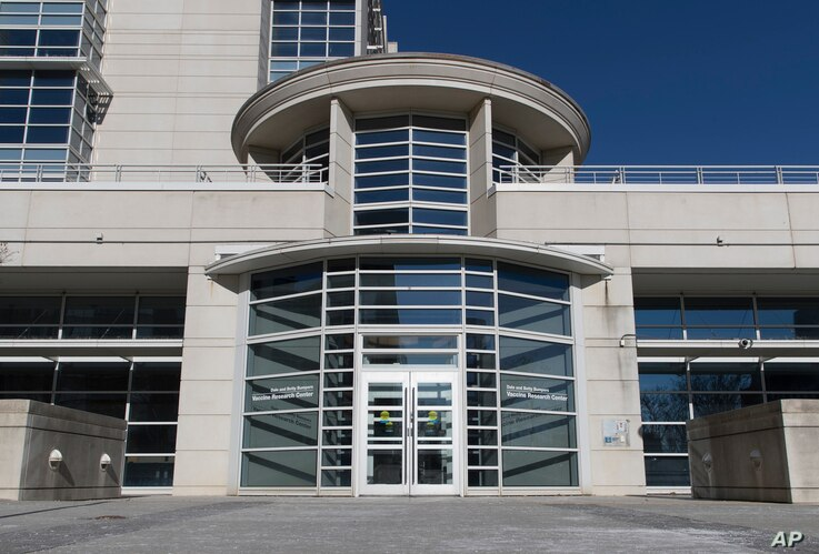 FILE - The entrance of the Dale and Betty Bumpers Vaccine Research Center is seen at the National Institutes of Health  in Bethesda, Md.