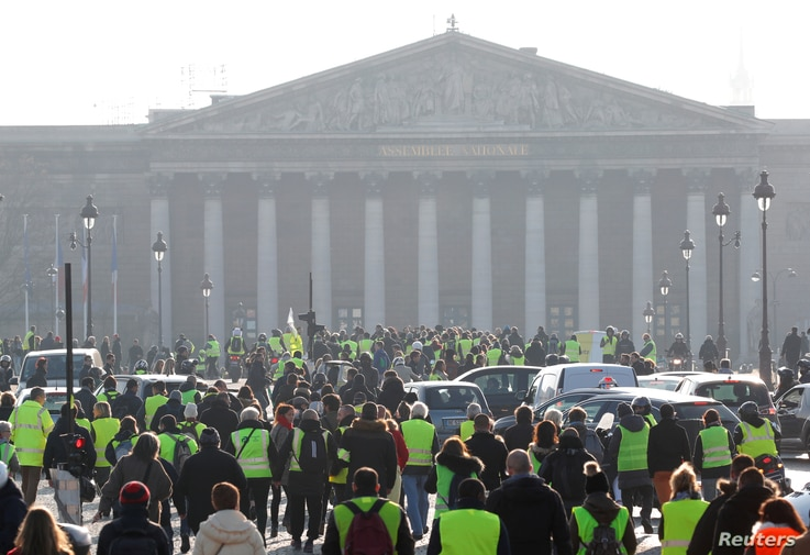 """Yellow vest"" protesters are seen gathered near the National Assembly in Paris, France, Nov. 17, 2018."