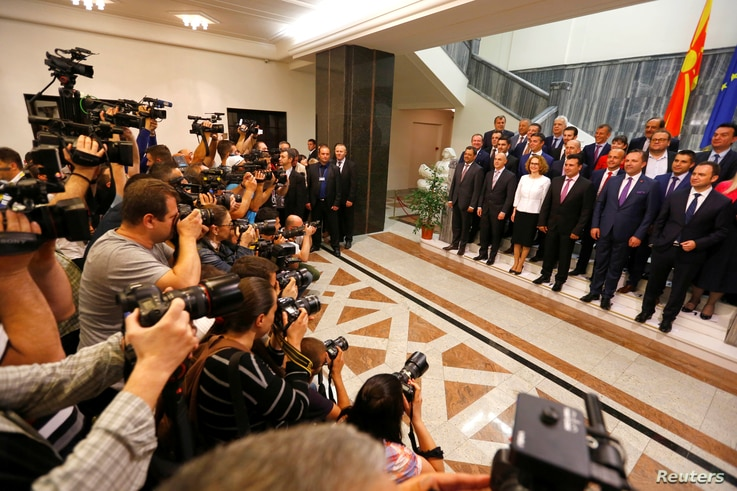 Social Democrat leader Zoran Zaev poses for a photo with newly elected ministers at Macedonian parliament in Skopje, Macedonia June 1, 2017.