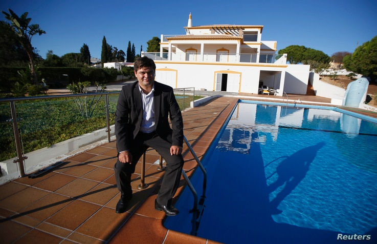 FILE - Vyacheslav Eshanu, head of PortugalEstate, poses at a house which is selling for two million euros in Portimao, Nov. 11, 2013.  A shattering economic crisis later, Spain and Portugal are trying to resurrect their moribund property markets by o...