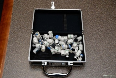 A locked case containing bottles of Tramodol uncovered by U.S. federal investigators in the home of U.S. Coast Guard Lt. Christopher Paul Hasson in Silver Spring, Md., in a photo provided Feb. 20, 2019.