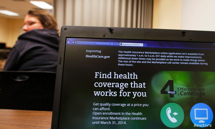 Liz Carlson, a self-employed student, attends a health care enrolment fair co-sponsored by Planned Parenthood of Northern New England and the State Employees Association at Great Bay Community College in Portsmouth, New Hampshire November 9, 2013. Ca...
