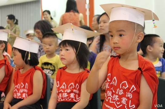 Children in Chicago 'graduate' from a Chinese American Service League program of bilingual and bicultural affordable daycare on August 22, 2013