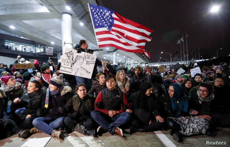 People gather to protest against the travel ban imposed by U.S. President Donald Trump's executive order, at O'Hare airport in Chicago, Illinois, Jan. 28, 2017.