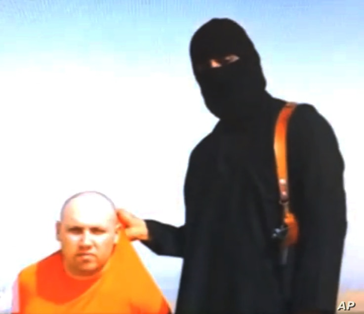 This still image from an undated video released by Islamic State militants on Tuesday, Aug. 19, 2014, purports to show journalist Steven Sotloff being held by the militant group. The Islamic State group has threatened to kill Sotloff if the United St