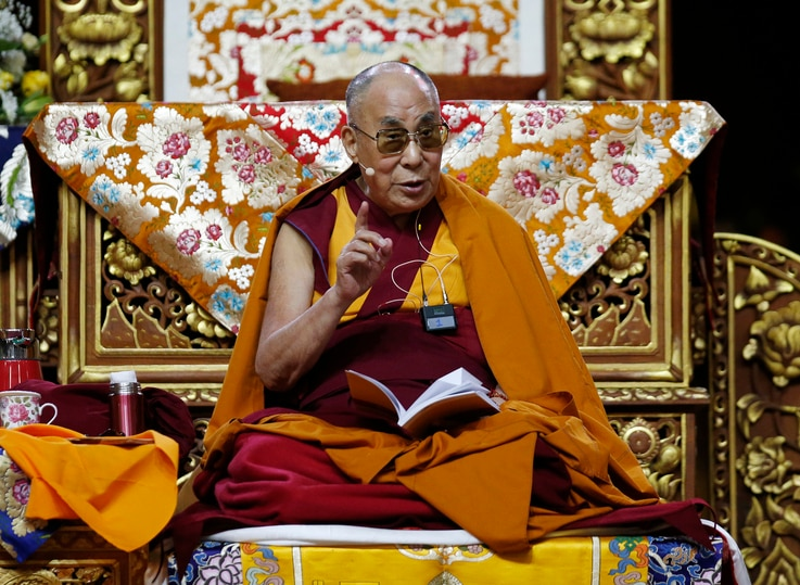 The Dalai Lama Tenzin Gyatso delivers his message as he attends a fair in Milan.