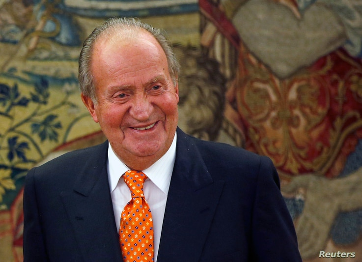 Spain's King Juan Carlos smiles in one of his latest audiences at the Zarzuela Palace outside Madrid, May 27, 2014.