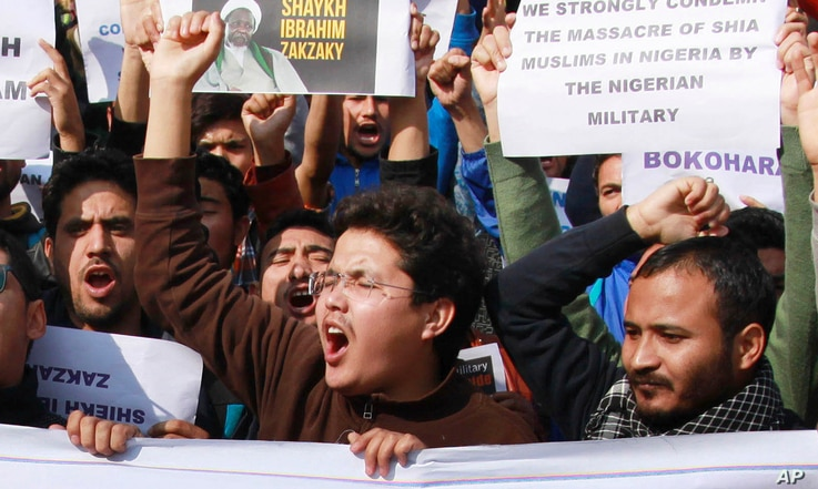 Muslims students carry placards and shout slogans against the Nigerian government against the killings of hundreds of Shiite Muslims and detaining their leader Ibraheem Zakzaky in Nigeria, in Jammu, India, Tuesday, Dec. 15, 2015.