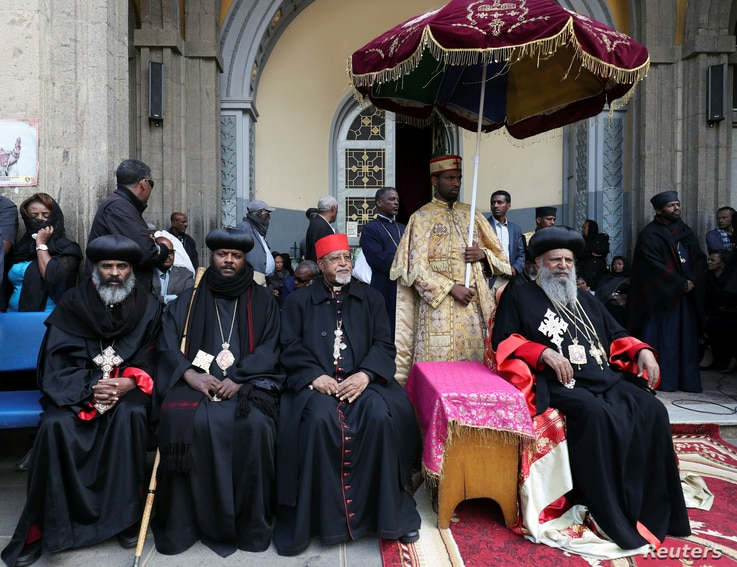 Priests attend the burial ceremony of the Ethiopian Airlines Flight ET 302 crash victims at the Holy Trinity Cathedral Orthodox church in Addis Ababa, March 17, 2019.