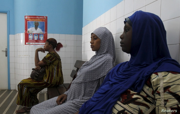 Women sit at a maternity hospital in Treichville, Abidjan, Ivory Coast, May 28, 2015.
