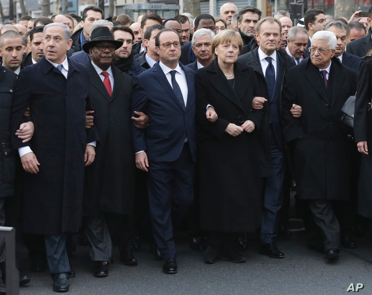 L-R: Israel's Benjamin Netanyahu, Mali's Ibrahim Boubacar Keita, France's Francois Hollande, Germany's Angela Merkel, the EU's Donald Tusk, and Palestinian President Mahmoud Abbas march during a unity rally in Paris January 11, 2015.