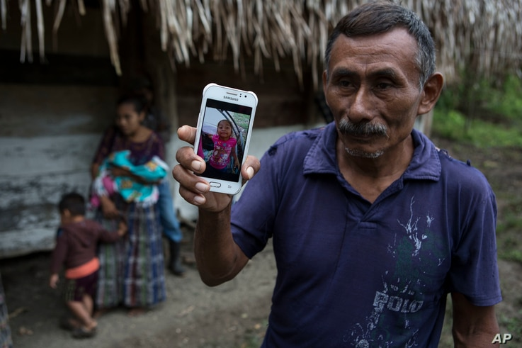 Domingo Caal Chub, 61, holds a smartphone displaying a photo of his granddaughter, Jakelin Caal Maquin, in Raxruha, Guatemala, Dec. 15, 2018. The 7-year-old girl died in a Texas hospital, two days after being taken into custody by U.S. Border Patrol ...