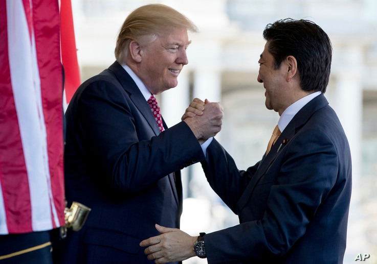 President Donald Trump welcomes Japanese Prime Minister Shinzo Abe outside the West Wing of the White House in Washington, Feb. 10, 2017.