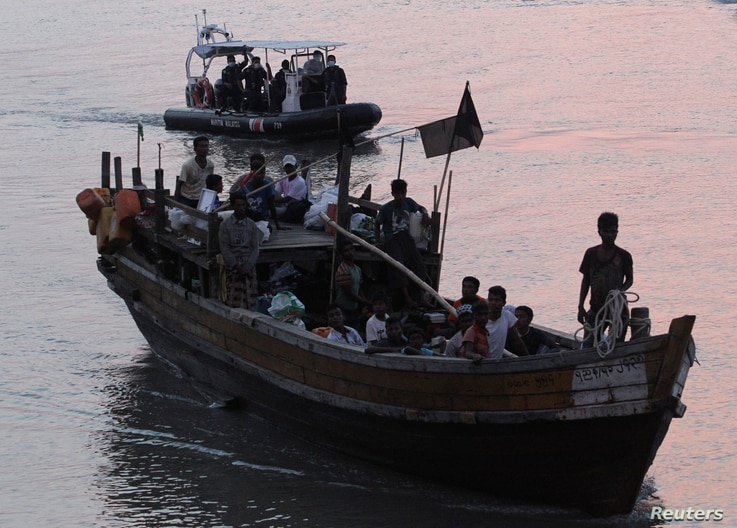 Rohingya refugees, who were intercepted by Malaysian Maritime Enforcement Agency off Langkawi island, are escorted in their boat as they are handed over to immigration authorities, at the Kuala Kedah ferry jetty in Malaysia, April 3, 2018.