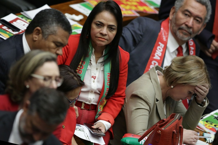 Ruling party lawmakers react after the lower house of Congress voted to impeach Brazil's President Dilma Rousseff in the Chamber of Deputies in Brasilia, Brazil, April 17, 2016.