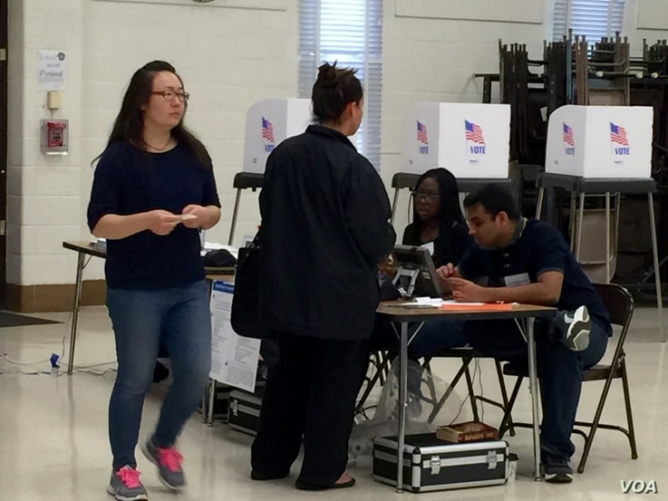 Voters arrive at a polling station at Watkins Mill Elementary School in Montgomery Village, Maryland, April 26, 2016.