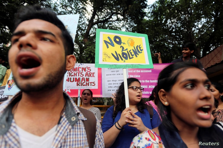 FILE - Demonstrators shout slogans during a protest against the rape and murder of a law student in the southern state of Kerala, in Mumbai, India, May 11, 2016.