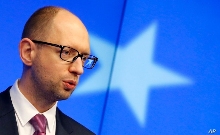 Ukraine's Prime Minister Arseniy Yatsenyuk speaks during a media conference at an EU summit in Brussels on March 6, 2014.