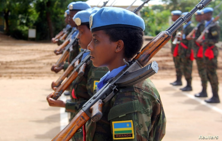 FILE - Rwandan peacekeepers from the Rwanda Defence Force (RDF) parade after arriving in Juba, South Sudan, Aug. 8, 2017.