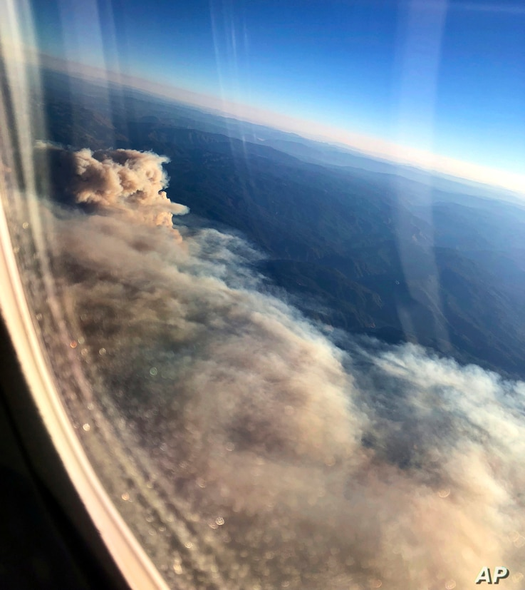 Smoke from wildfires burning in Northern California obscures the Sierra Nevada in this view from an airliner approaching Sacramento, Calif., Nov. 9, 2018.