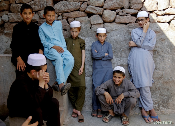 Students wait for prayer time at the Al-Nadwa Madrassa in Murree, Pakistan, Oct. 24, 2017.