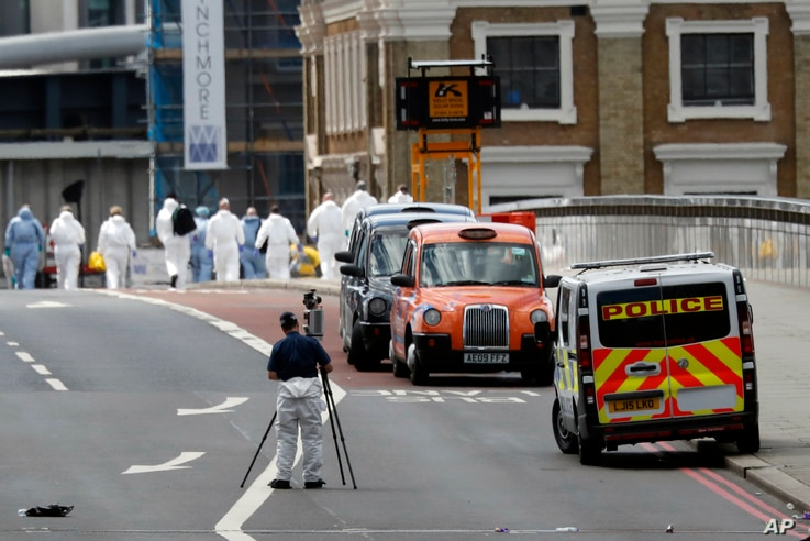 Forensic police work within a cordoned off area after an attack in the London Bridge area of London, June 4, 2017.
