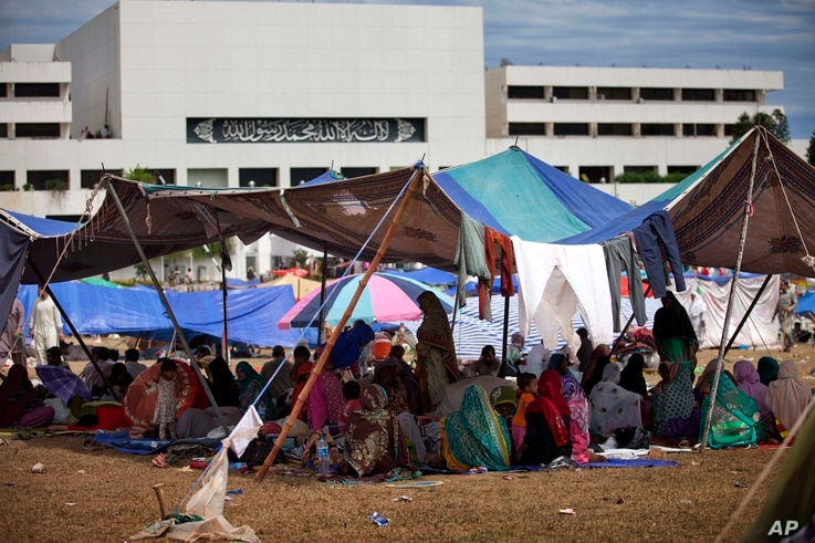 Supporters of Muslim cleric Tahir-ul-Qadri camp inside the vicinity of the parliament building in Islamabad, Pakistan, Tuesday, Sept. 2, 2014. Pakistan's lawmakers held an emergency session Tuesday over the political crisis roiling the country as tho