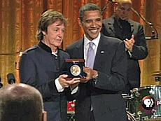 President Barack Obama presents Paul McCartney with the Gershwin Prize for Popular Song at the White House.