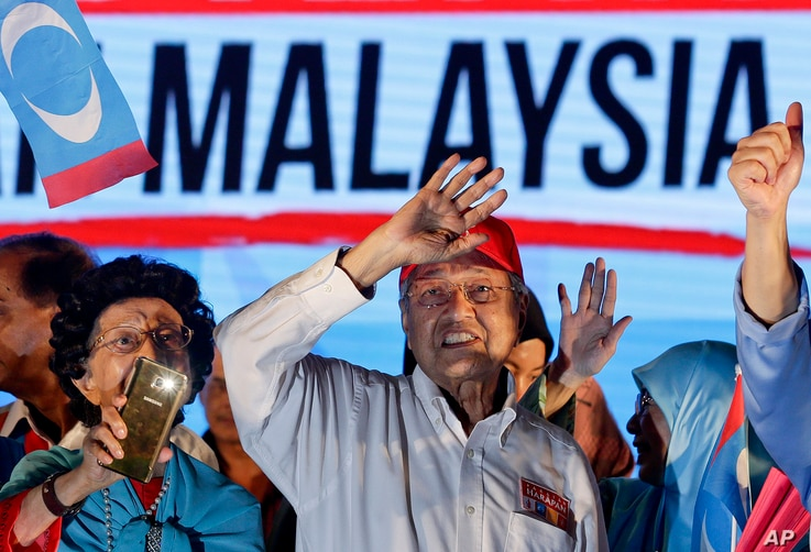 Former Malaysian strongman Mahathir Mohamad waves to the crowd during an election campaign in Kuala Lumpur on Sunday, May 6, 2018.