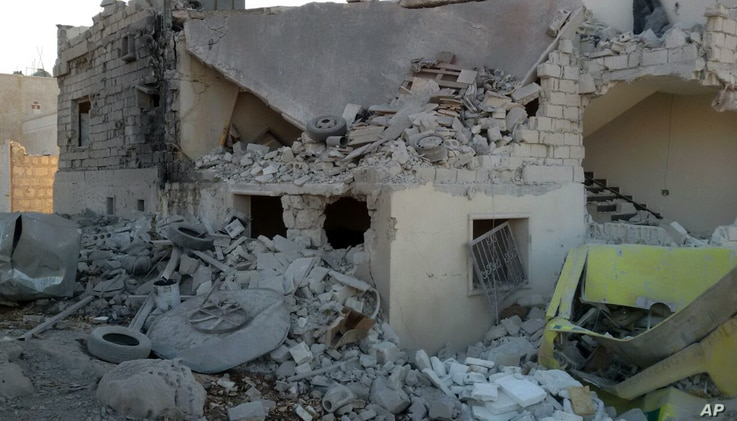 This photo provided by the Shafak Charity Organization, which has been authenticated based on its contents and other AP reporting, shows the badly damaged exterior of a medical facility dedicated to women after it was hit by four airstrikes in the no...