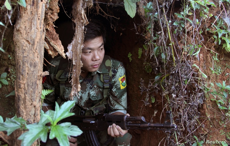 FILE - A Kachin Independence Army (KIA) soldier sits inside the bomb shelter along the bunker at the front line of Alen Bum near Laiza, the headquarters of KIA in Kachin State, Myanmar, Nov. 30, 2016.