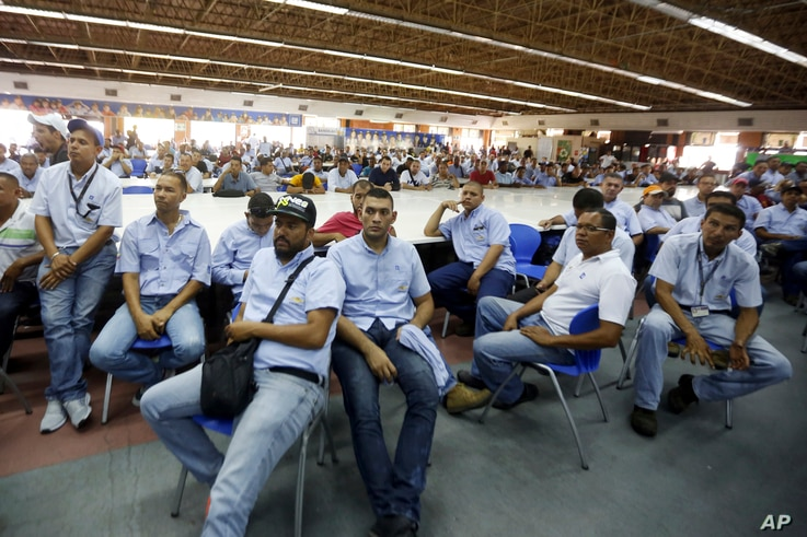 Workers of General Motors listen during a meeting with government officials at the company's plant in Valencia, Venezuela, April 20, 2017.