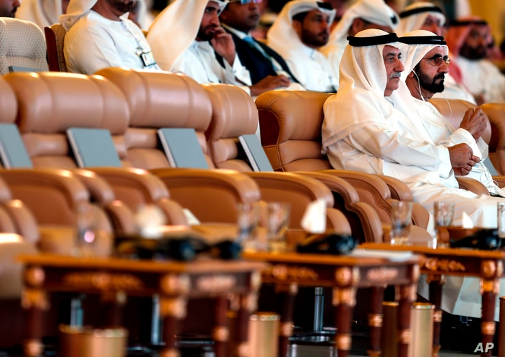 United Arab Emirates Prime Minister Sheikh Mohammad bin Rashed, right, and Ibrahim al-Assaf, Saudi State Minister, attend the opening of the Future Investment Initiative conference, in Riyadh, Oct. 23, 2018.