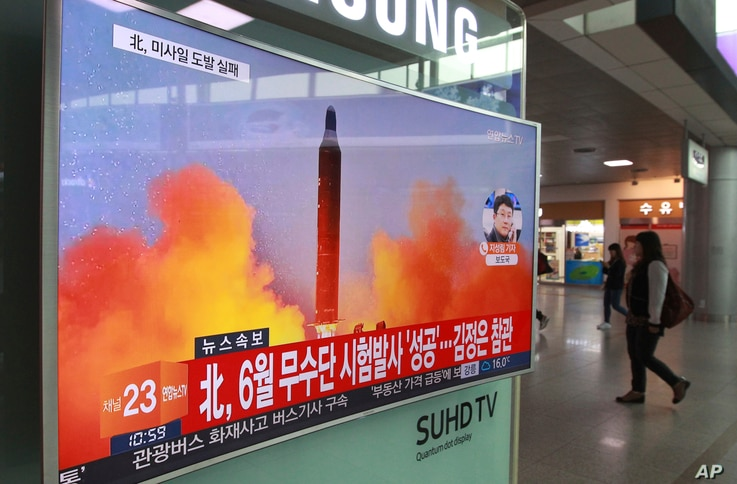 A TV screen shows a file image of a missile launch conducted by North Korea in a local news program, at Seoul Railway Station in Seoul, South Korea, Oct. 16, 2016.