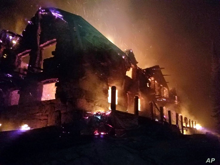 This image from video provided by the Hutton Incident Team shows the historic main Sperry Chalet building engulfed in flames in Glacier National Park, Mont., Aug. 31, 2017. Glacier National Park's historic Sperry Chalet was lost to the Sprague Fire o...