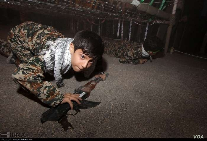 Photo posted on Iran's state-run news agency site, IRNA purportedly shows a child being educated on how to fire weapons at Iran's perceived Western enemies.