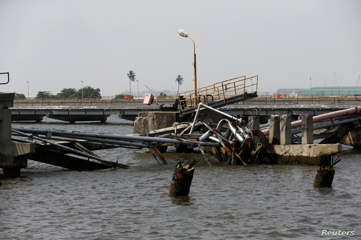 An oil discharge facility which was used to transfer imported oil from ships at the Atlas Cove depot, is seen damaged after militants from the Niger delta bombed it, in Lagos, Nigeria, Nov. 10, 2016.