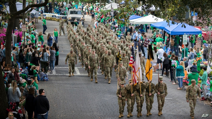 Members of the Georgia Southern University Army ROTC Eagle Battalion march in the 195-year-old Savannah St. Patrick's Day Parade, March 16, 2019, in Savannah, Ga.