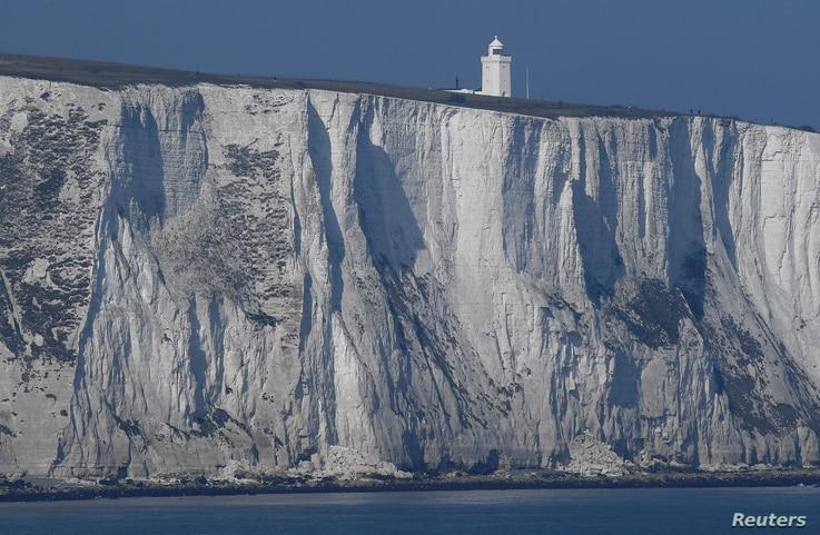 South Foreland lighthouse and the white cliffs of Dover are seen from a cross-channel ferry between Dover in Britain and Calais in France, March 27, 2017.
