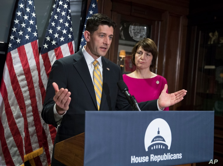 House Speaker Paul Ryan of Wisconsin, accompanied by Rep. Cathy McMorris Rodgers, R-Wash., takes questions from reporters at Republican National Committee Headquarters in Washington, May 17, 2017.