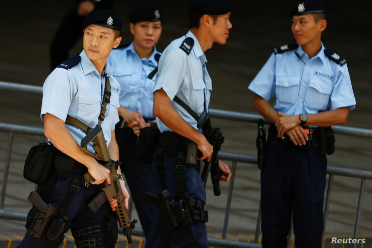 Armed policemen secure the area around the hotel where Chinese President Xi Jinping will stay in Hong Kong, June 29, 2017.